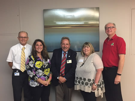 HSS Executive Director Robert Cole, Jeanne Borromeo-Otty, Ed Cote, and HSS board members Jan Crawford and Bob Polansky celebrate the completion of the COA site visit.