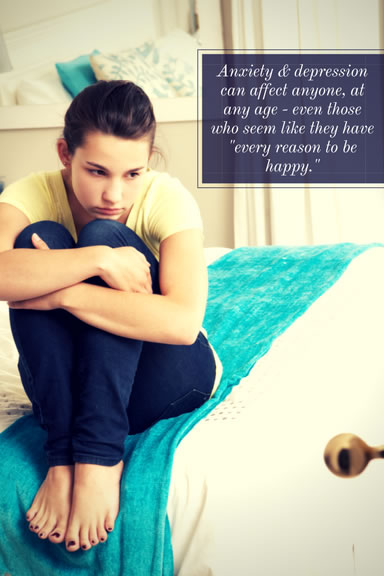 teen in bedroom with depression