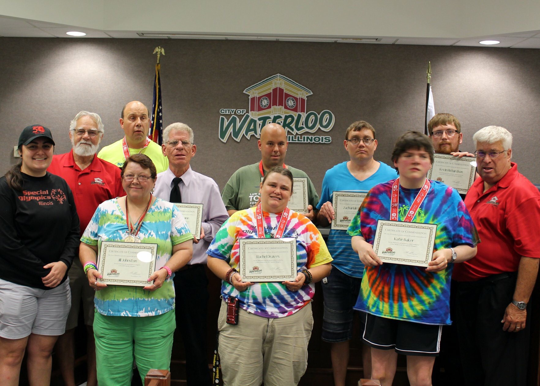 Special Olympics group getting certificate.