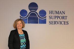 Anne King named Executive director with the logo of HSS on her back